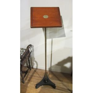 Mahogany and brass reading stand with tilt adjustment and an ebonised base.