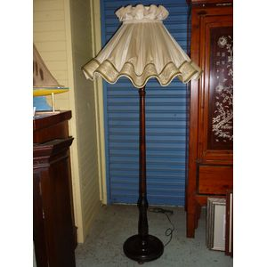 A tall wooden lamp stand made