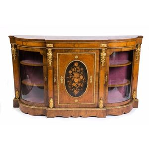 A fine 19th century English marquetry and ormolu side cabinet. The well figured burr walnut breakfront top above a frieze,...