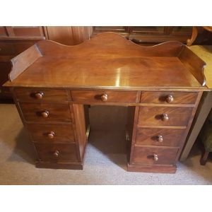 Early victorian flame mahogany nine drawer desk/sideboard/cabinet ,great storage an impressive antique . In excellent condition...