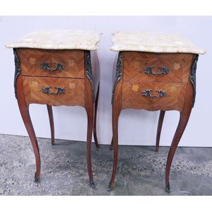 A pair of kingwood  marble top Louis XV marble top inlayed bedside cabinets. Two drawers set on cabriole legs with ormolu...