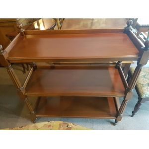 Antique australian cedar three tier dumbwaiter . Porcelain casters fluted legs , a good size not to big in excellent condition .
