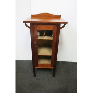 Petite arts and crafts blackwood cabinet, single glass door with two shelves, cut out supports, in excellent condition.