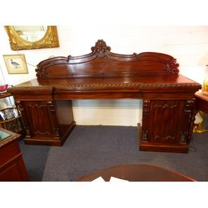 William 1V mahogany sideboard of classical design, being 8 foot long (244 cms) having a central drawer and cupboards each end...