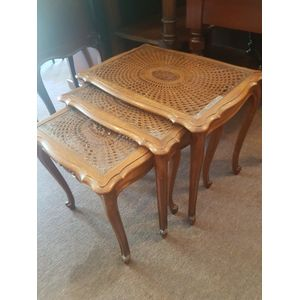 French nest of three oak tables ,fine carvings scrolled foot . Cane and glass tops in great condition .