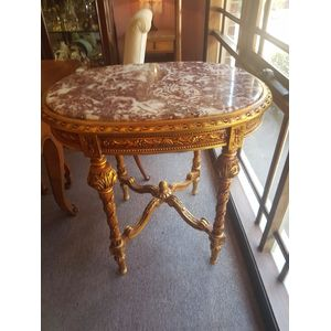 Gilt framed centre table with rouge marble top , elaborate legs apron and cross stretchers  . In excellent condition .