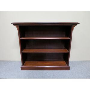 A small mahogany open bookshel