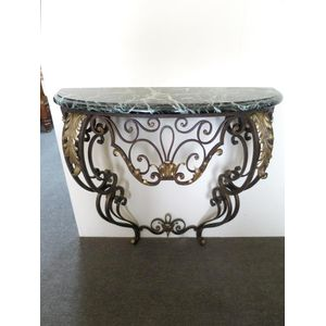 French Art Deco wrought iron wall console with a demilune marble top on a beautifully scrolled base with leaf detail. Circa...