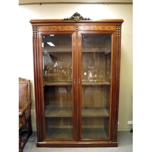French mahogany 2-door bookcase in the Louis XVI style, inlaid with kingwood and pearwood marquetry and featuring finely cast...
