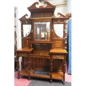Grand and impressive oak edwardian hall stand with all brass hooks and three beveled mirrors. Turned columns and decorative...