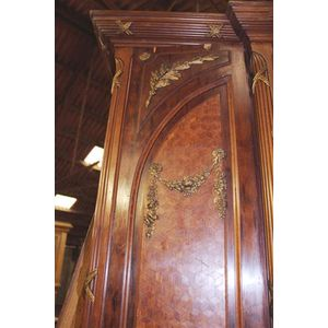 A fine quality Armoire featuring decorative inlays and gilt bronze mounts. Central door has a beveled mirror with done top....