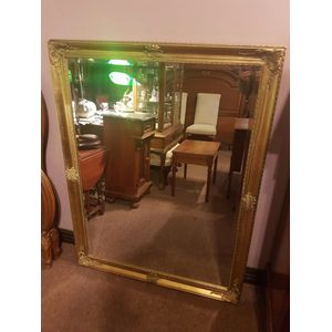 Large gilt framed bevilled wall mirror. In great condition,dimensions overall frame .  Hanging chains both ways .