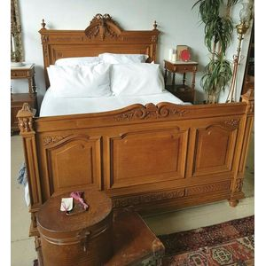 A superb carved, French oak queen size bed in the Henry II style. Beautifully detailed with original bed rails extended to fit...