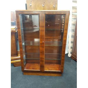 Art Deco display cabinet in Blackwood and Queensland walnut with bevelled glass doors and adjustable glass shelving. Pure deco...