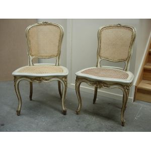 Pair of elegant eighteenth century painted and gilded French Louis XV period chairs, circa 1775. Replacement cane to backs and...