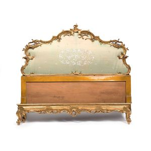 A fine quality late 19th century Italian giltwood bed in the Chippendale taste. The fretted giltwood frame is finely carved...