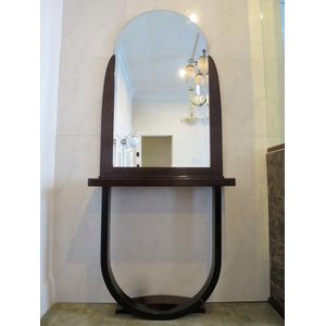 A superb Modernist French Art Deco console in rosewood featuring a large arched and partly frameless mirror above a hooped base....