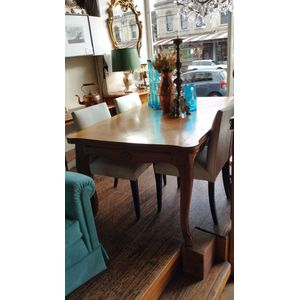 A pale oak extension table wit