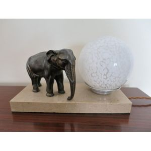 A French Art Deco table lamp on a marble base featuring and elephant and retaining the original glass shade. In excellent...
