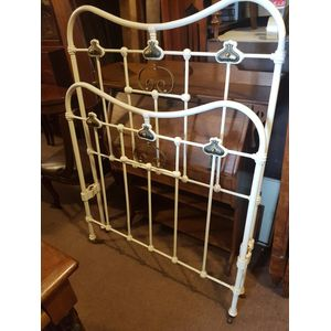Art nouveau antique cast iron king single bed .Brass decoration castors rails and slat base . 42 inches wide .